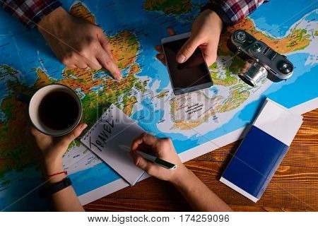 hands point on map where to go travel planing vacation