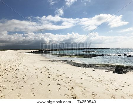 Cero Brujo Beach on San Cristobal Island. Cerro Brujo (Witch Hill) is a white sand beach near a hill located on the northern part of the Island.