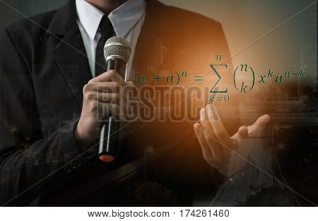 College professor speech and teaching with microphone about mathematical or physical equation
