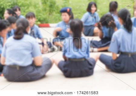 Thailand secondary education students are sitting for activity group in in school with uniform blurred students