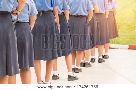 Thailand secondary education girl students are standing in line in high school with uniform