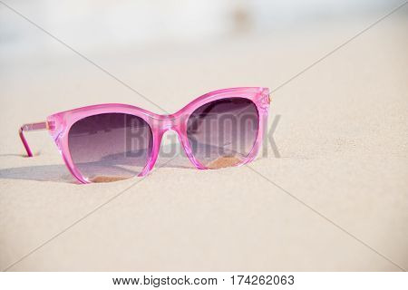 pink sun glass on the beach Vacation concept.