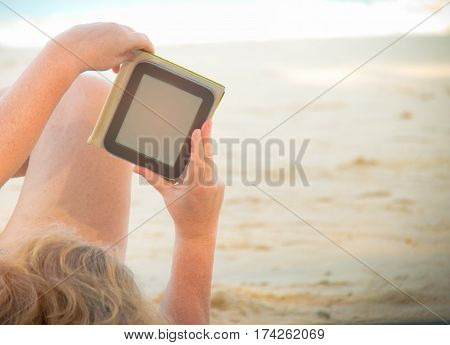 woman and smartphone in hand on beach Vacation concept