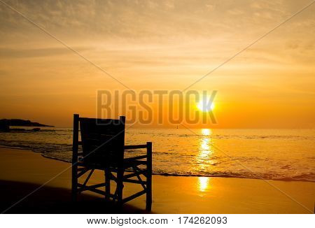 beach chair loungers on deserted coast sea at sunrise Vacation concept