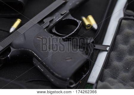 9 mm gun on gun storage box on the table.