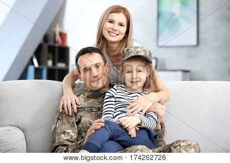 Happy soldier and his family at home
