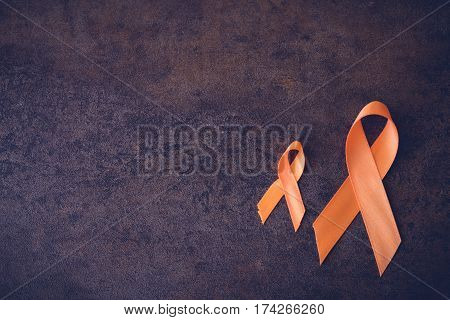 Orange Ribbons On Toning Background, Leukemia Awareness, Self Injury Awareness Day, Multiple Scleros