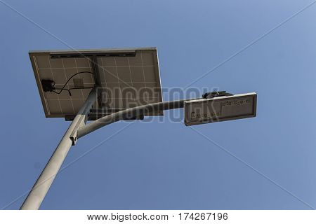 solar pannel and LED street lamp pole on blue sky