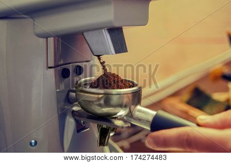 Drop-down Freshly Ground Coffee In The  Holde