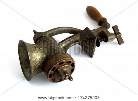 Old meat grinder with shadows on white background