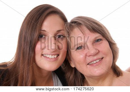 mother and daughter cheek to cheek, isolated on white