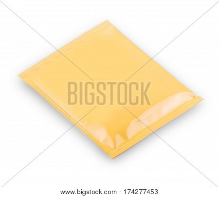 Blank yellow plastic sachet for medicine drugs coffee sugar salt spices isolated on white background . with clipping path