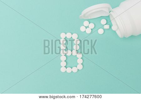 Bottle With Vitamin B Pills Forming The Letter 'b'