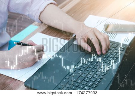 Business Trading Concept : Man Trade Stock And Forex By Laptop