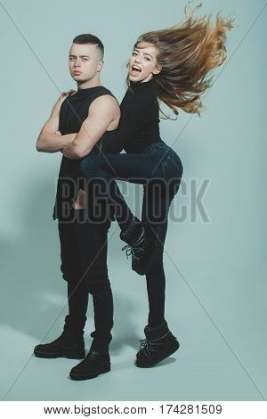 Pretty Sexy Woman With Long Hair And Man In Black