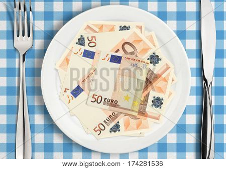 Money on plate , finance concept .