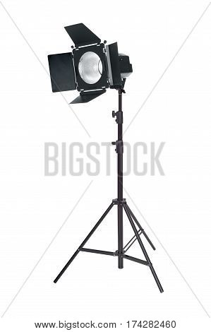 Studio lighting on a tripod stand isolated on a white background. Spot light photography equipment.