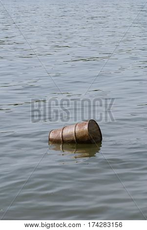 Water Pollution - Floating Oil Barrel