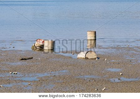 Water pollution: discarded oil drums, color image