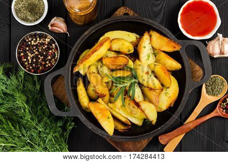 Fried Potatoes With Fresh Rosemary In Cast-iron Pan. Top View.