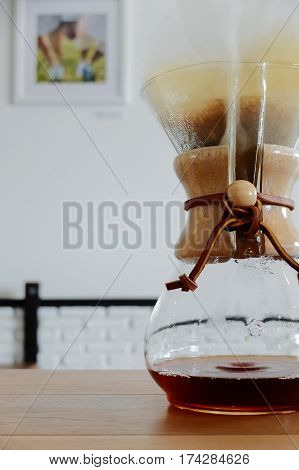 Brewing Third Wave Coffee With Chemex Glass On Wooden Table