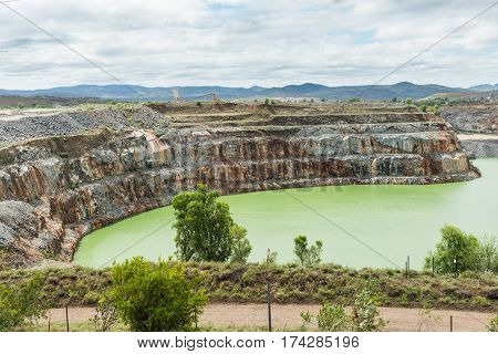 Open cut gold mine pit no longer used and full of water