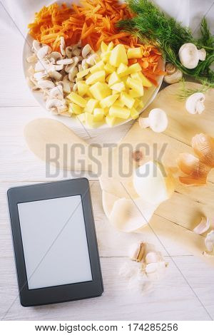 ingredients for soup and ebook, top view