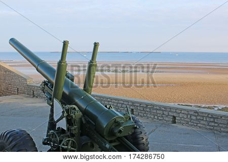 anti-aircraft gun at the Normandy beach of Arromanches, France