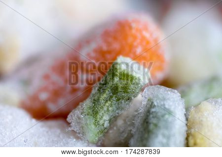 The macro shot of frozen vegetables - carrots and broccoli