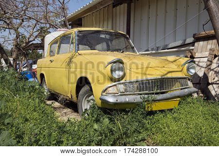 Yellow Old-timer Car In Green Grass