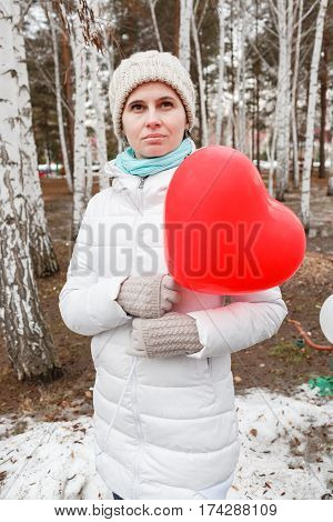 The Woman Keeps The Inflatable Balloon In The Wood