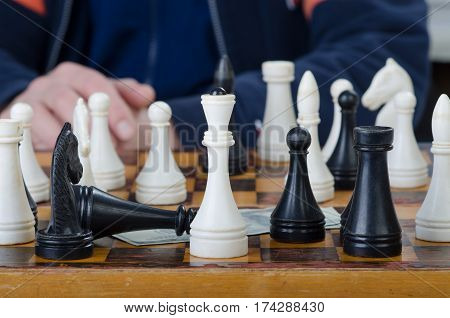 white and black figures on a chess-board