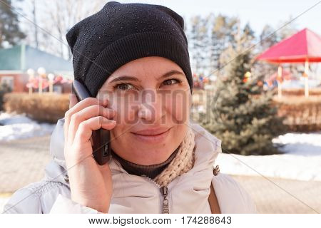 The Woman Speaks By Phone On The Street