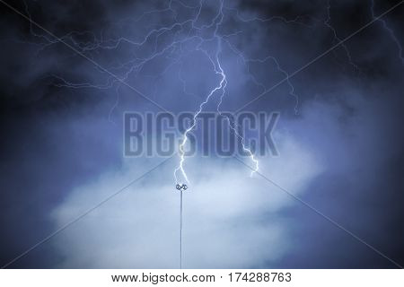 Lightning rod against a cloudy dark sky. Natural electric energy.