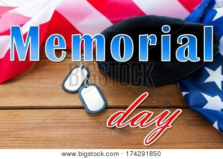 military forces, patriotism and national holidays concept - memorial day words over american flag, soldiers badges and paratrooper hat on wood