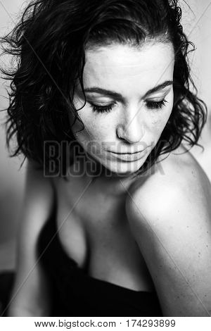 Crying girl with tears and smudged make up on eyes. Black and white photo