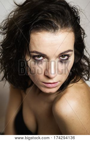 Horny woman with smudged make up on eyes