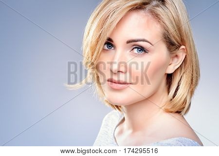 Close-up portrait of a beautiful well-groomed middle-aged woman. Skincare, rejuvenation, cosmetics.