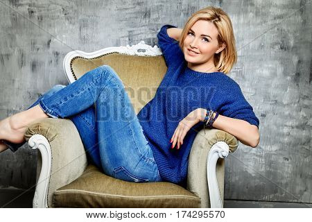 Beautiful middle-aged woman in casual clothes. Skincare, rejuvenation, cosmetics. Women health. Studio shot.
