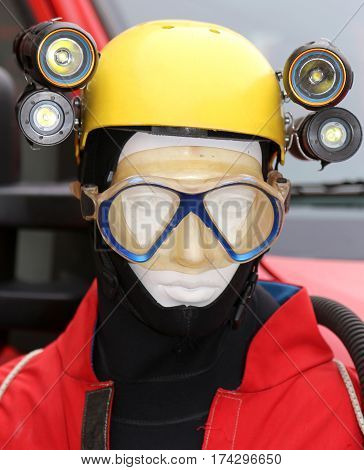 professional equipment for emergencies during emergencies and caving expeditions with a dummy is a yellow protective helmet