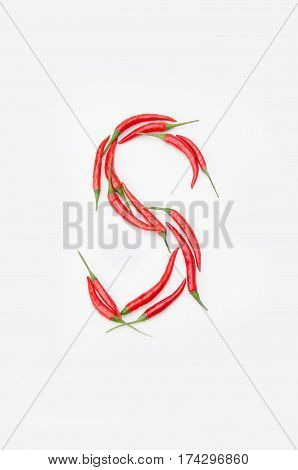 Bold letter S Latin alphabet of red hot chili pepper on a white background