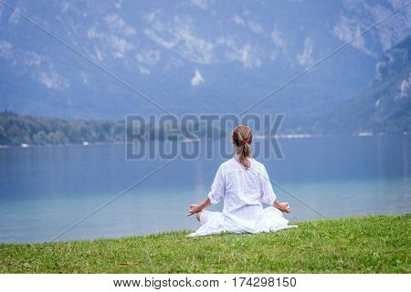 serenity and yoga practicing at the lake Bohinj. Slovenia