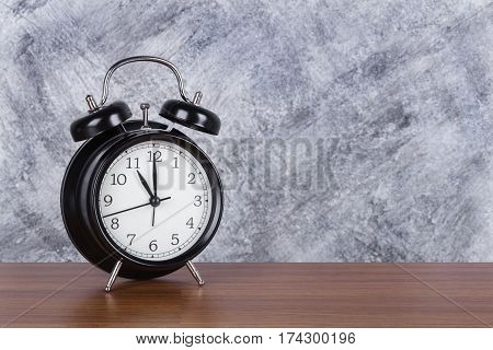 11 O'clock Vintage Clock On Wood Table And Wall Background