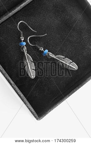 Pair of silver and turquoise earrings in black jewel box