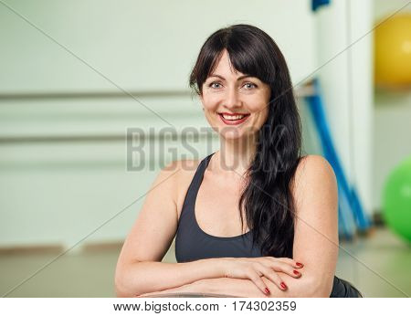 Portrait of young attractive smilimg sportswoman after training in gym