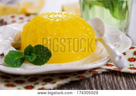 Traditional panna cotta with lemon and mint. Selective focus.