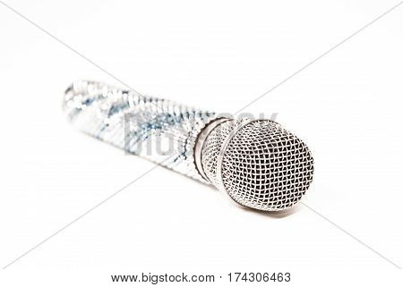 voice microphone decorated with Swarovski crystals on a white background