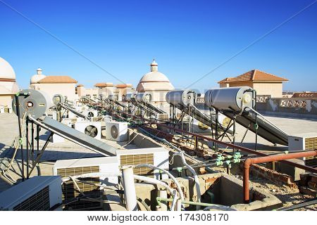 Conditioners and tanks for heating of water on a roof of the Egyptian building