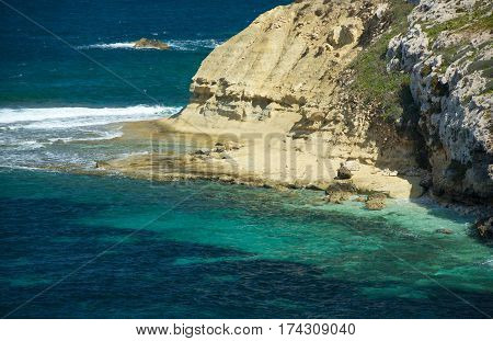 Yellow stone coast in St Pawls island in Malta on sunny nice day with emerald clear sea, St Pawls island, Malta, Europe, rocky bay in Saint Pauls island, Malta