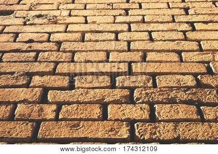 Yellow brick wall background photo. Outside view